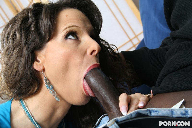 beautiful woman sucking a black dick