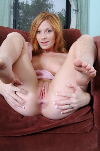 redhead spreading her legs showing off her pussy