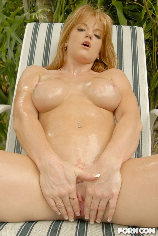 oiled tits and she's spreading her pussy