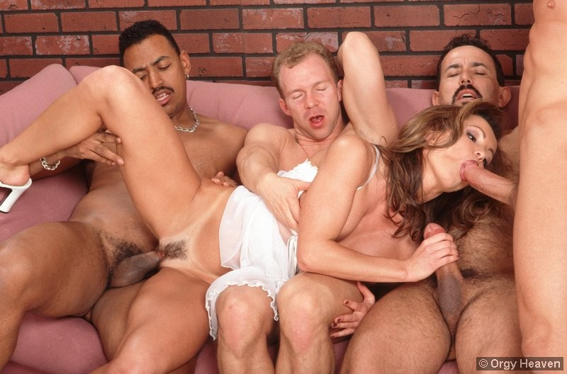 happy guys fuck a chick during an orgy