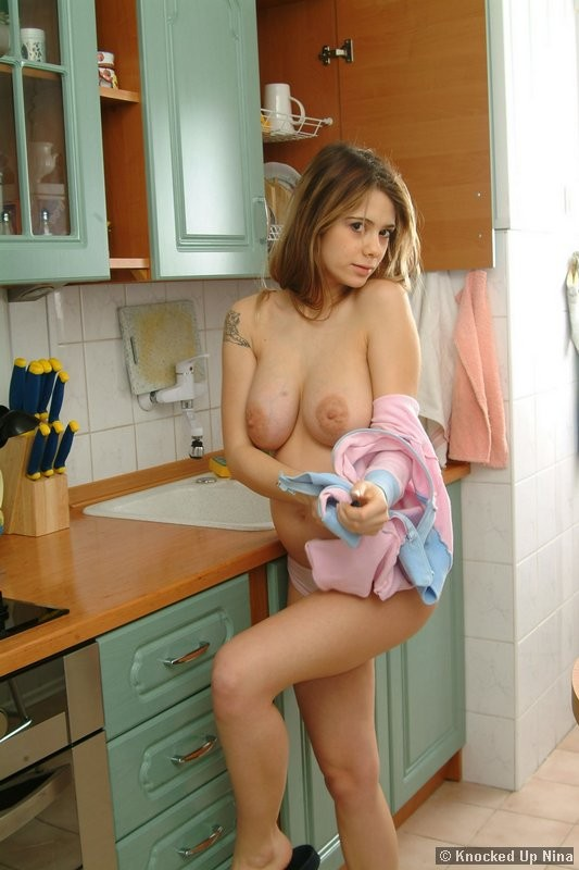topless pregnant woman