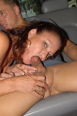 cock sucking girl in a car